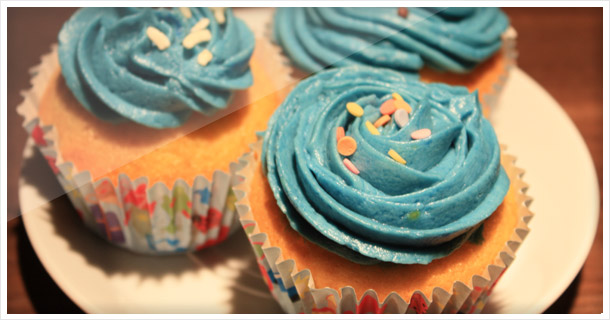 Vanilla cupcakes with baby blue buttercream frosting