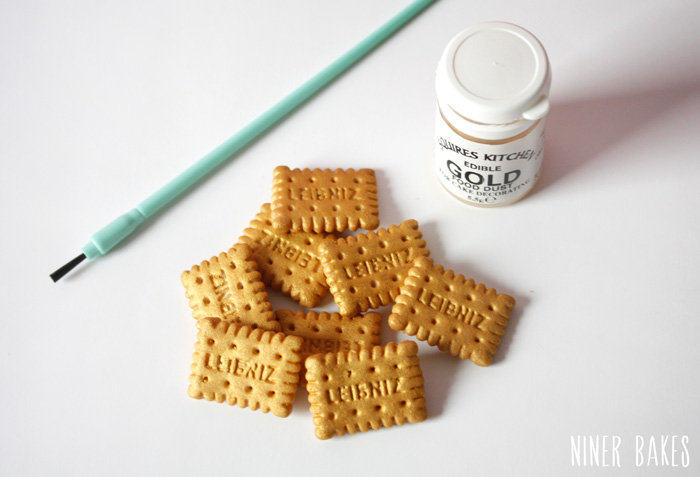 mini Leibniz cookies (or any other cookie), golden luster dust, edible glue